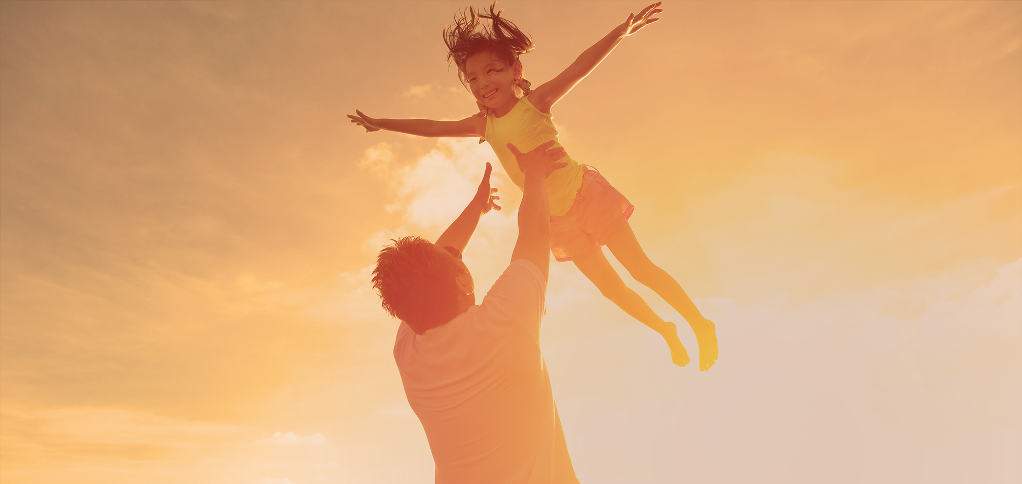 dad throwing daughter into air